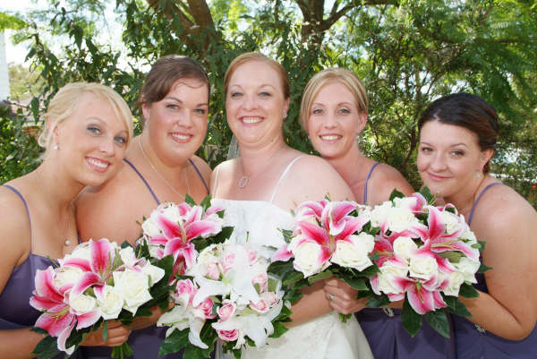 bridal party with pink and white bouquets