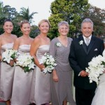a bride, her parents and three bridesmaids