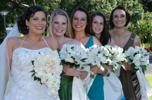 Bridal party, bridesmaids wearing shades of green