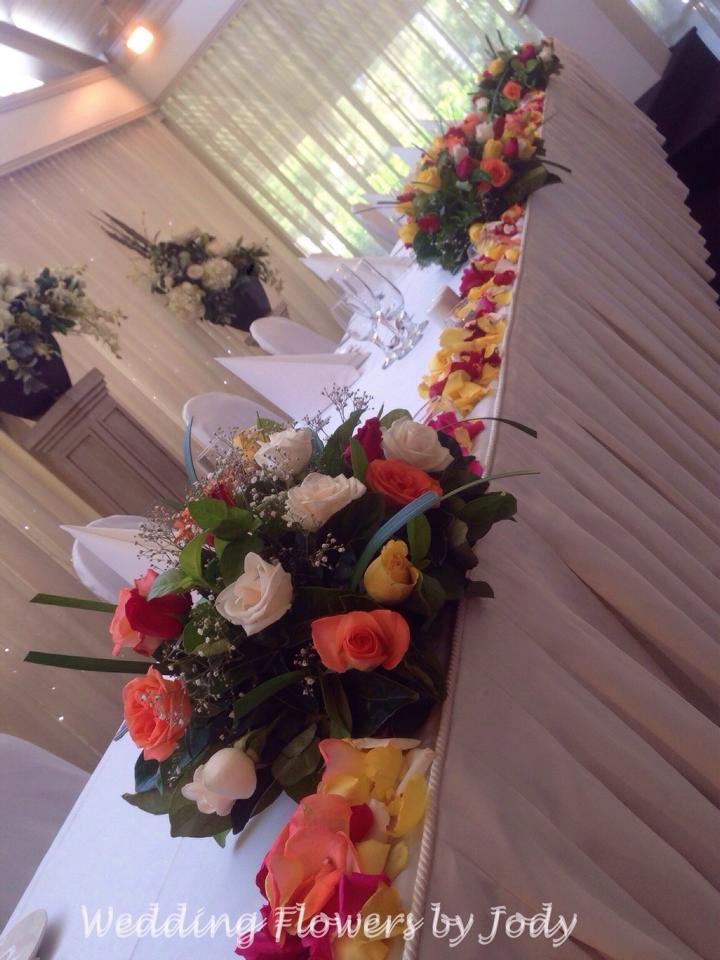 brightly coloured floral table arrangement